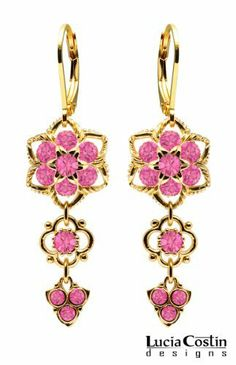 24K Yellow Gold Plated over .925 Sterling Silver Flower Shaped Dangle Earrings by Lucia Costin with Pink Swarovski Crystals and 4 Petal Flowers, Garnished with Twisted Lines; Handmade in USA Lucia Costin. $62.00. Floral design accompanied by cute details. Mesmerizing enough to wear on special occasions, but durable enough to be worn daily. Unique jewelry handmade in USA. Lucia Costin flower shaped drop earrings. Amazingly studded with rose Swarovski crystals