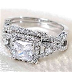 18 k white gold wedding ring set Brand new 18 k white gold filled with lab created diamonds engagement wedding ring set. ( engagement ring and wedding ring) Available in all sizes. Swarovski Jewelry Rings