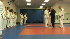 Zack recieving stripe promotion in Junior Champs BJJ class!