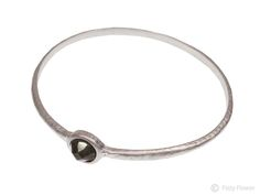 Tutti & Co bangle with dark grey stone inset