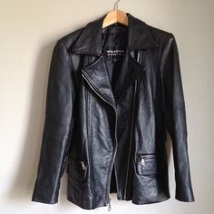 SALE! Authentic Wilsons Leather Moto Jacket small Size Small Wilson's leather jacket. Two pockets on each side (one zip and one with top flap). Jacket is in very good condition! Size small but can fit larger sizes as well. I normally wear a medium and fits perfect. Please ask if you have any questions. Also has belt loops incase you wanted to wear a belt with it Wilsons Leather Jackets & Coats