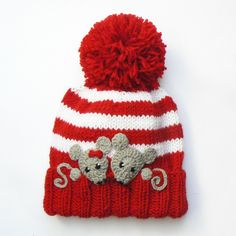 Hand knitted winter pom pom hat for kids. Cute hat with two crocheted bear appliques sewn onto. Choose your size and color using drop-down menu. Available sizes: -Toddler 18-20 -Child 19-21 -Teen/Adult small 20.5-22 Available colors: -Green -Yellow -White -Red -Blue -Pink -Gray -Black Made