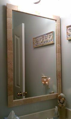 My bathroom mirror was so plain.  I gave it a nicer look with a tile border.