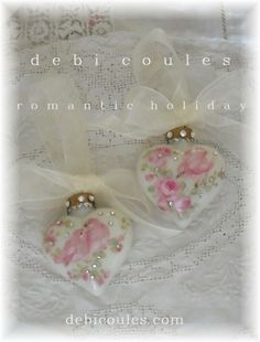My beautiful Pink Lovebird Jeweled Glass heart ornaments are available at http://www.debicoules.com/category_40/Holiday-Ornaments.htm Hope you catch one before they fly away!
