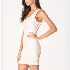 White party dress Bebe sequin double-v dress. Worn once. Perfect condition. bebe Dresses Mini