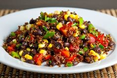 Easy Quinoa and Black Beans INGREDIENTS: 1 tablespoon olive oil, 1 onion, chopped, 5 cloves garlic, peeled and chopped, 3/4 cup uncooked quinoa, 1 1/2 cups vegetable broth, 1 teaspoon coriander, 1 heaping teaspoon ground cumin, 1/4 teaspoon cayenne pepper, salt and pepper to taste, 1 can organic sweet corn, 2 (15 ounce) cans black beans, rinsed and drained, ¾ cup chopped fresh cilantro