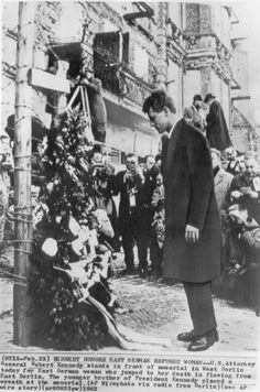 "*""U.S. ATTORNEY GENERAL ROBERT F. KENNEDY ~ stands in front of a memorial in West Berlin today for an East Berlin woman who jumped to her death in fleeing from East Berlin. The younger brother of President Kennedy placed a wreath at the memorial."" (February 23rd, 1962)"