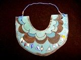 Ancient Egyptian Collar, made with construction paper, yarn, beads, markers, and sequins.