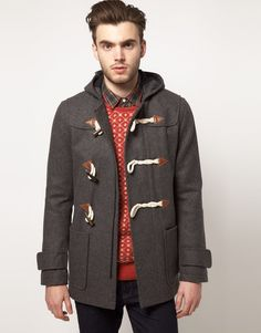 A shorter take on the usually longer Duffel Coat, there's an ease to this look, throw on a knit cardigan, jeans, boots and go. -LS