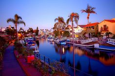 Napels Canals in Long Beach, CA. <3 The Gondola rides, through the canals, are so much fun, as you're with your hunny, drinking Champagne, and seeing some magnificent homes..some of the Gondoliers, that guide you and your Gondola, actually have great voices, and serenade you <3