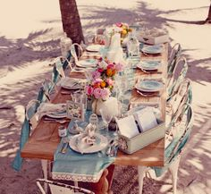 The casual, beachy table setting of our Fall 2014 collection shoot is SO perfect for a casual wedding. #davidsbridal #fall2014