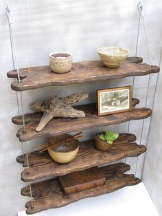 driftwood shelf, but use rope and boat cleats to hang it.