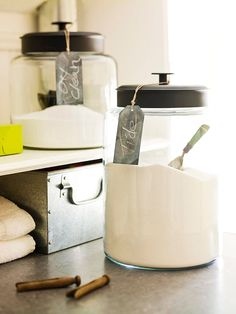 Display everyday items like detergent, dryer sheets, muffin liners etc. in clear canisters and add a chalk paint tag