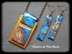 Mokume gane technique: rubber stamps and textures pressed into thin stacked layers of different color polymer clays, razor blade remove thin layers at a time to reveal multi colored images.