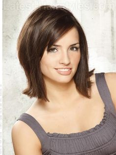Modern Bob  Chocolate tresses are shaped into a beautiful modern bob with dimensional layers and sweeping bangs. This length is slightly longer that a traditional bob which keeps it fresh and sleek. The short to medium layers throughout add volume and interest and also keep this cut from looking heavy.