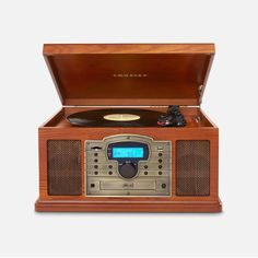 Turntable with a CD player and AM/FM radio. Product: Turntable Construction Material: Wood and metal Color: Paprika Features: CD PlayerRecord player AM/FM radio Retro design Hand-rubbed finish Dimensions: H x W x D Radios, Usb Turntable, Wedding Gift List, Blue Suede Shoes, Record Players, Cassette, Built In Speakers, Usb Drive, Retro Design