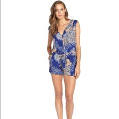 BCBG Floral Romper BCBG Max Azria tan & blue floral romper, size 8. New and never worn, no tags. BCBGMaxAzria Other