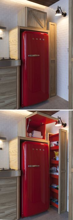 The cabinets that surround this bright red SMEG fridge, have a hidden pop of colour that matches the color of the fridge.
