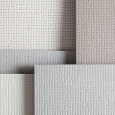 Tiny dimples and raised dots cover these ceramic tiles by French designers Ronan  Erwan Bouroullec