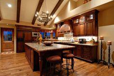 Mediterranean Kitchen with Breakfast bar, Glass panel, Stone Tile, Flush, Complex granite counters, Undermount sink, L-shaped