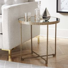 Features:  -Mirrored top with embossed metal base in bright gold with black tipping.  -Premium quality materials with unique high-style design.  Shape: -Round.  Design: -Table.  Style (Old): -Contempo