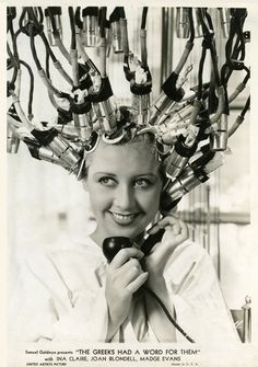 Joan Blondell.  Good Lawd, I suppose she is getting a Perm?!