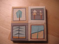 Mini quilts by Erin Wilson, fantastic artist in Brooklyn, NY. Photo by Vilseskogen, via Flickr (Creative Commons licensing, free to share if you give credit)