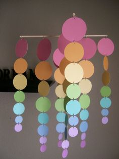 Colorful mobile made from paint swatches.  This would be a rainy day project for kids