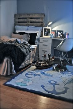 Little boy's room...nautical, and I like the pallet behind the bed