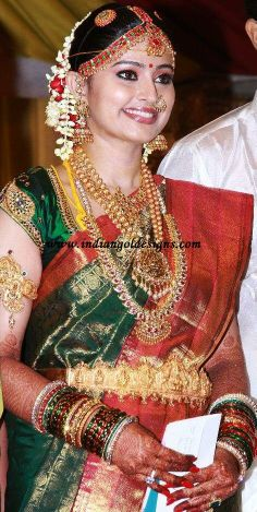 sneha in green bridal saree on her wedding day