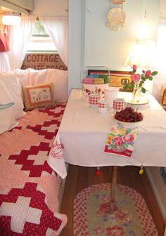 What a cute inside trailer. Love the throw rug...