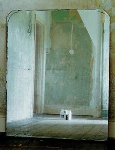 This photograph, called Little House in the Mirror, is by Martin Koralczyk.  Isn't it stunning?