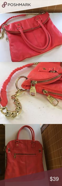 Steve Madden Bag Mango colored Steve madden bag in really soft leather with gold hardware and zippers multiple different ways to wear this bag it has a cross body option shoulder bag and small handles in excellent condition Steve Madden Bags Shoulder Bags