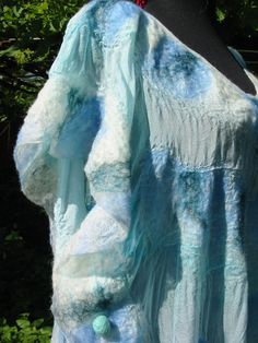 Felted soft merino wool over natural silk in sweet sky blue color. Long summer blouse of kimono type , M-size, elegant and high fashion style.  Care instructions: The felt is easy care. Wool is a unique organic fiber and has a self-cleaning ability. However, if necessary, you can wash it. For better result and long lasting quality of the felt use gentle hand wash at 30C (86F) in slightly warm water with hair shampoo. Do not change the water temperature when you rinse out the soap. (If you…