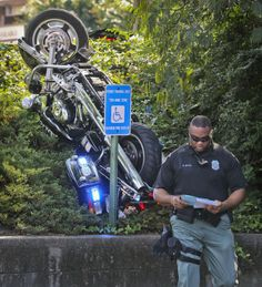 MARTA police officer, K. Gotell collects information at the scene Monday. A MARTA police officer was hospitalized after the motorcycle he wa...