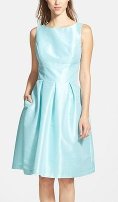 Timeless fit-and-flare bridesmaid dress by Alfred Sung. This style is a universally flattering silhouette structured by princess seams with a full A-line skirt and pleats. Comes in 11 colors, including this pretty mint blue/green!