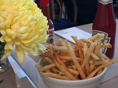 "A photo of a bowl of the lovage fries sits on the table beside a yellow flower and Heinz ketchup at Diane's Bloody Mary in San Francisco. Learn more about this little local spot by reading the FoodWaterShoes article, ""You Say Tomato, I Say Bloody Mary – Diane's Bloody Mary in San Francisco, California"" - Food Foodie Foodies FoodPorn Cocktails Food Shop Eat Restaurants Eats Eating Food Breakfast Brekkie Brunch"