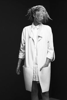 I have a softer all white Calvin Klein Trench coat (all my grandmothers vintage clothing) that could work beautifully with black and white
