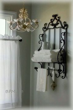 BackPorchMusings photos of master bath. Love the accessories and the chandelier makeover. Wall color is SW Front Porch. BackPorchMusings photos of master bath. Love the accessories and the chandelier makeover. Wall color is SW Front Porch. Chandelier Makeover, Black Towels, Wrought Iron Decor, Iron Furniture, Accent Furniture, Furniture Makeover, White Rooms, Home Accessories, Room Decor
