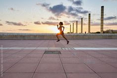 Strong woman running at sunset by Guille Faingold - Sportswoman, Athletic - Stocksy United Woman Running, Running Women, Urban Fitness, How To Run Faster, Strong Women, The Unit, Athletic, Stock Photos, Sunset