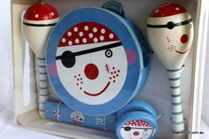 Pirate Music Set A stunning eye catching glossy pirate design in blue, white and red. Assists children in acquainting with different musical sounds. Non toxic paints and materials. Presented in a sturdy wooden crate, helps with gift wrapping!  Age 3+ Dimensions: 28cm x 21cm x 6cm