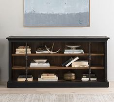 Rustic pine and metal bars pair neatly in this contemporary take on vintage library shelving. Rings fitted along the vertical bars of the Gavin Media Console allow adjustment to the shelf heights, and a cutout on the back facilitates cord manageme… Free Interior Design, Interior Design Services, Entryway Console, Entryway Tables, Pottery Barn Bookcase, Reclaimed Wood Media Console, Rustic Sideboard, Library Shelves, Vintage Library