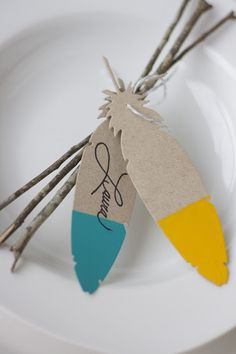 Anthropologie inspired feather tags as a place card.