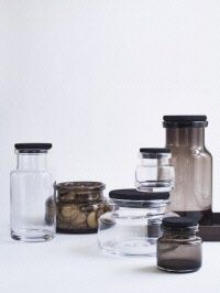 These glass containers are crafted from mouth blown glass and finished with a black stained cork lid. Store your stuff in the kitchen or use it as a vase. Glass Storage Containers, Kitchen Containers, Jar Storage, Bottles And Jars, Glass Jars, Kitchenware, Tableware, Container Design, Black Stains