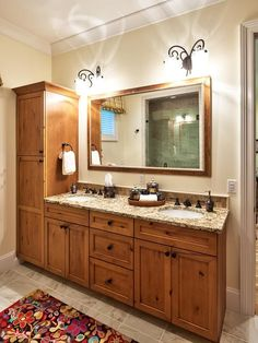 Bathroom Vanity With Blue Vessel Sink, Mirror & Flowers
