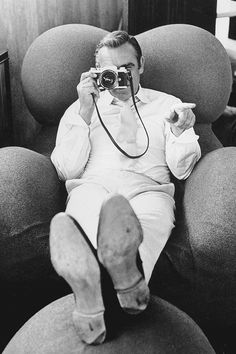 Sean Connery peers through a camera on the set of the James Bond film 'Diamonds Are Forever', photographed by Terry O'Neill, 1971.
