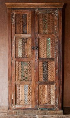 This sturdy, beautiful closet features antique wood blocks assembled on the door fronts to lend texture and character.  http://shopnectar.com/product-unicorn-furniture-64