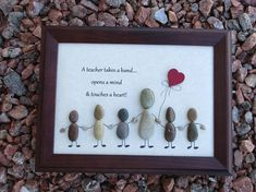 This is a lovely piece of rock & pebble framed art depicting a Teacher and his/her students with the word caption above stating A teacher takes a hand....opens a mind & touches a heart! The Teacher and students are all holding hands and a heart balloon is being held onto between