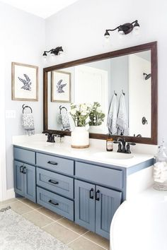 blue hardware and a large mirror with a wooden frame #bathroomwallfurnituremirror