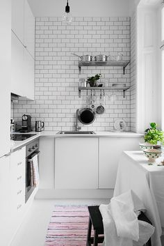 White kitchen in studio apartment